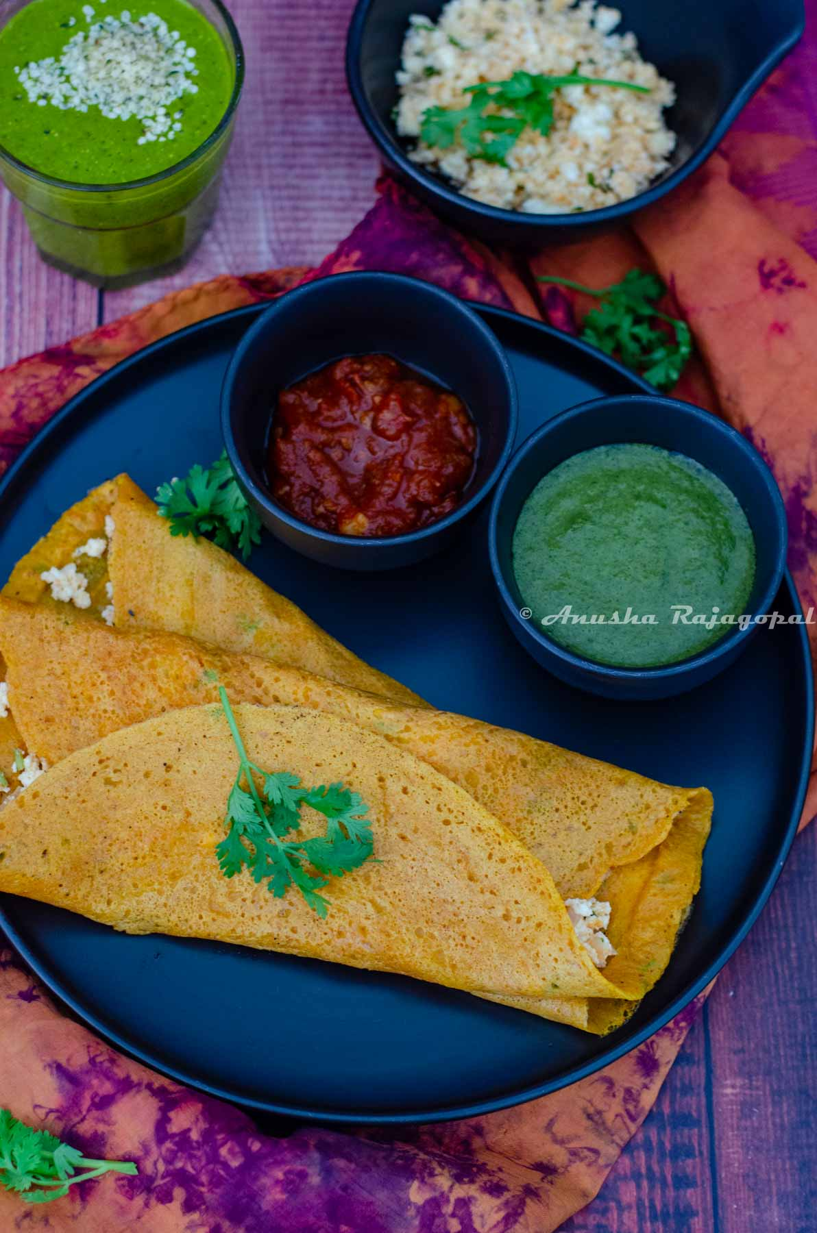 Moong dal cheelas stuffed with paneer and served with chutneys and a smoothie