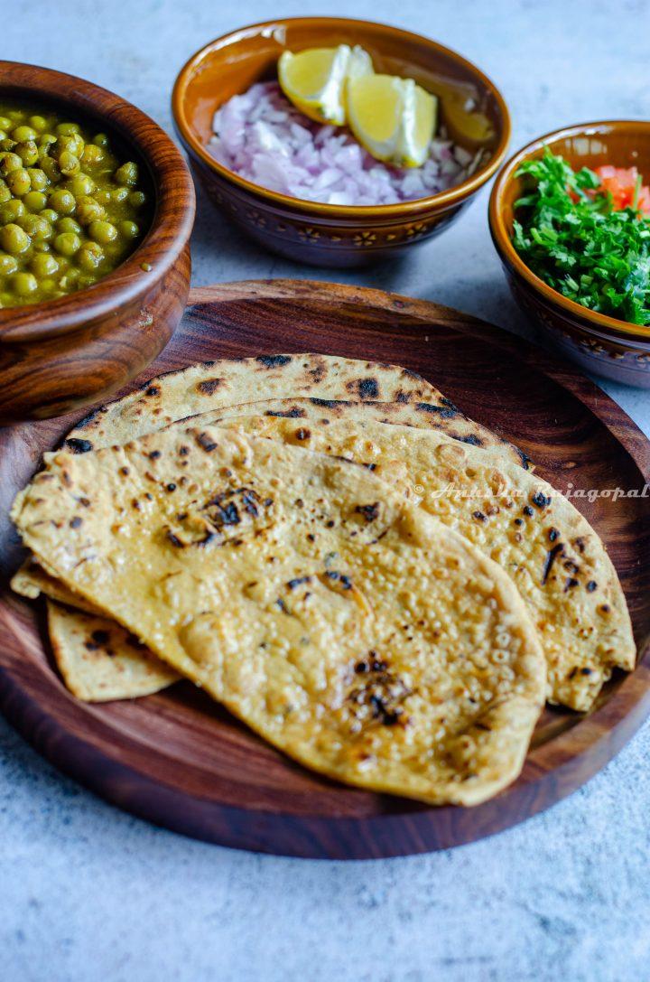 whole wheat kulcha served on a wooden platter