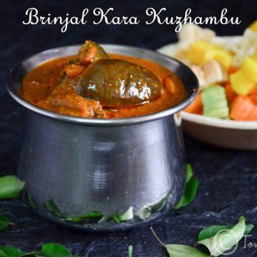 brinjal kara kuzhambu served with fryums at the backdrop