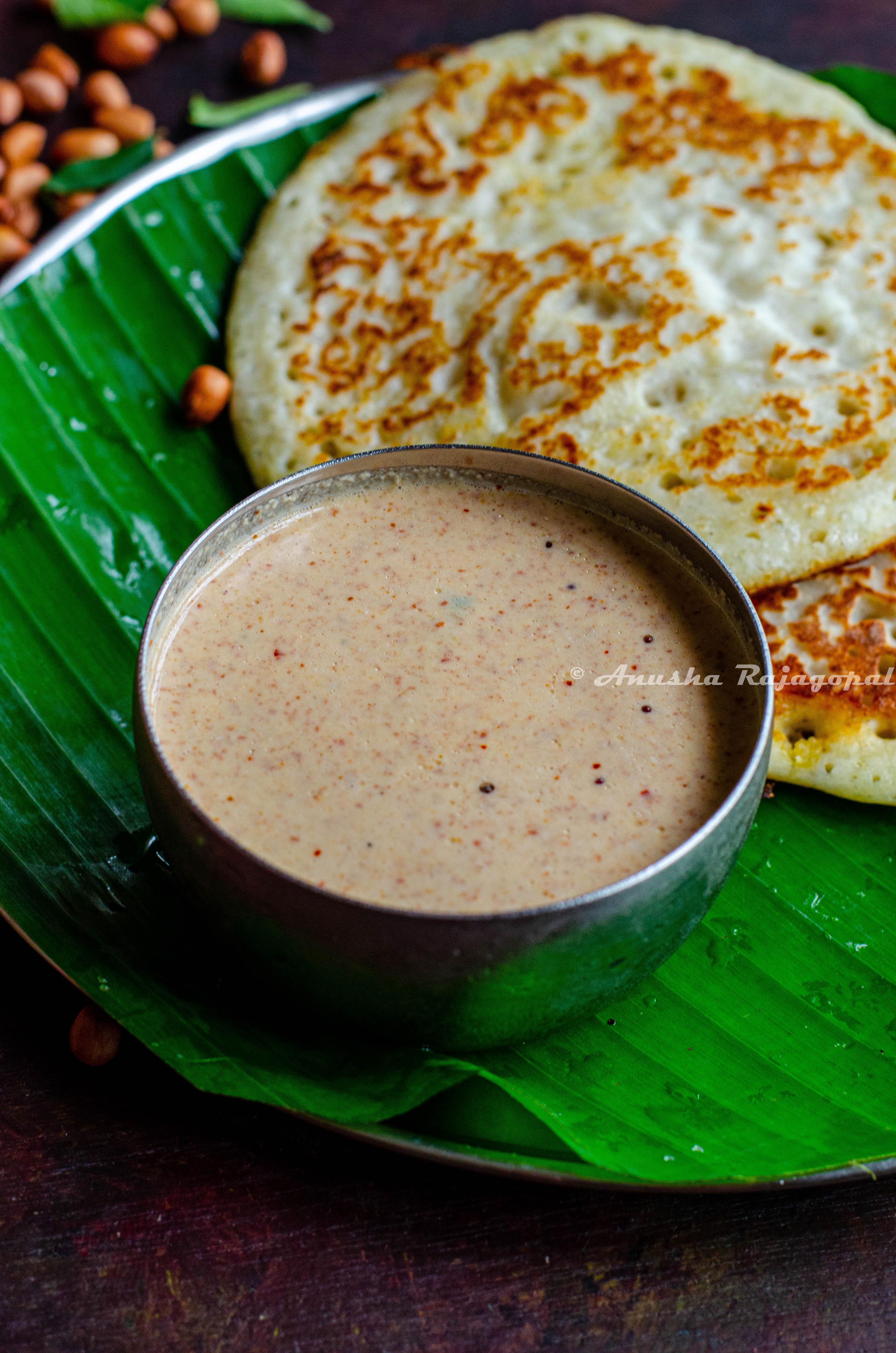 Palli chutney for dosa- vegan peanut chutney served with dosas on a banana leaf