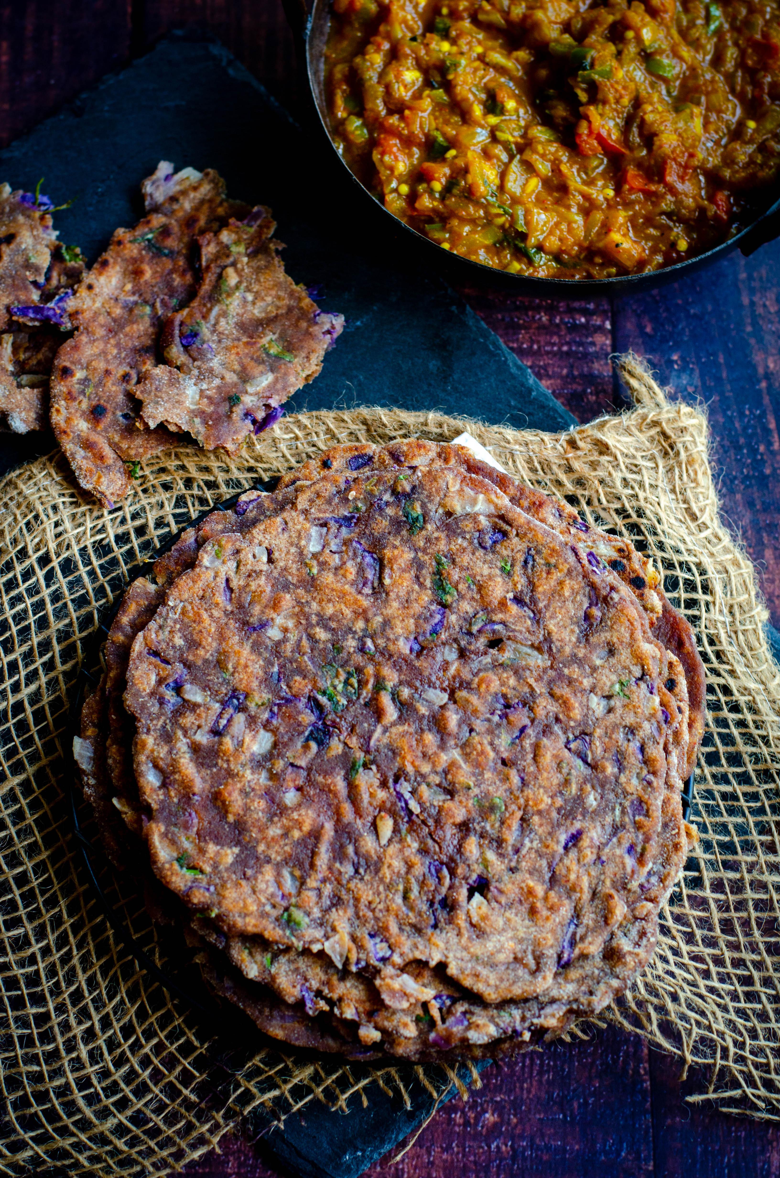 Ragi chapati with purple cabbage stacked and served with baingan bartha
