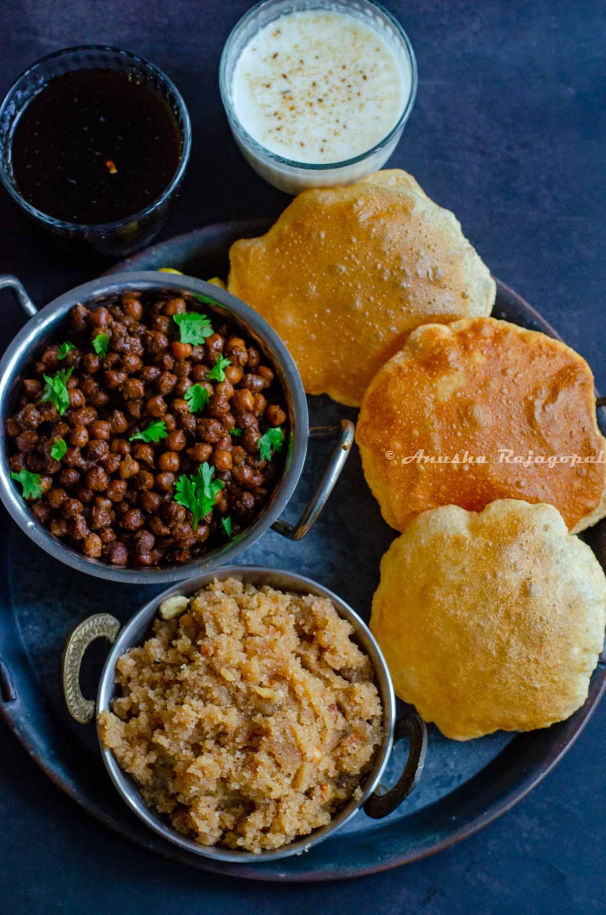 The Ashtami Prasad platter featuring sookhe Kala chana, sooji ka halwa, poori, chaas