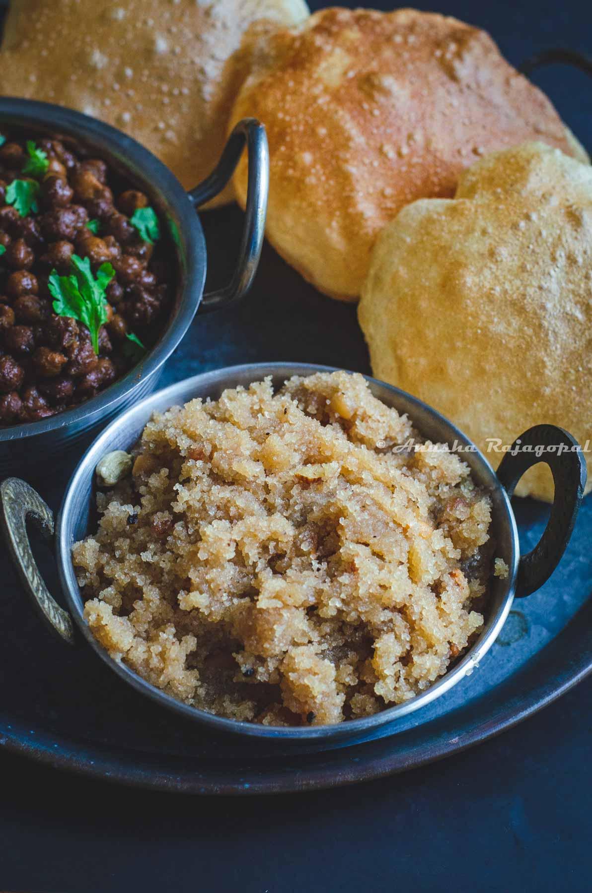 Sooji ka Halwa served on a grey platter with poori and kala chana